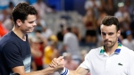 Canada's Milos Raonic, left, shakes hands with Spain's Roberto Bautista Agut after Raonic won their fourth round match at the Australian Open tennis championships in Melbourne, Australia, Monday, Jan. 23, 2017. (AP Photo/Dita Alangkara)