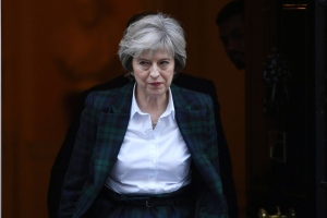 "Prime Minister Theresa May leaving Downing Street in London, ahead of her speech on Brexit Tuesday Jan. 17, 2017. May is to give further details of her plans for Brexit in a speech in which she will declare she does not want an outcome which leaves the UK ""half-in, half-out"" of the European Union. (Stefan Rousseau/PA via AP)"