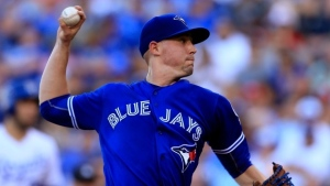 Toronto Blue Jays starting pitcher Aaron Sanchez delivers to a Kansas City Royals batter during the second inning of a baseball game in Kansas City, Mo., Saturday, Aug. 6, 2016. (AP Photo/Orlin Wagner)