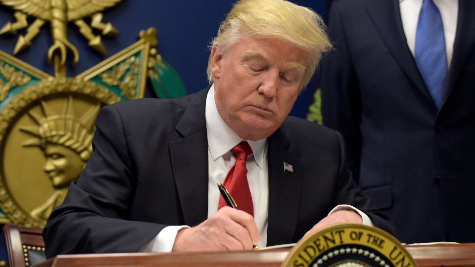 President Donald Trump signs an executive order on extreme vetting during an event at the Pentagon in Washington, Friday, Jan. 27, 2017. (AP Photo / Susan Walsh)