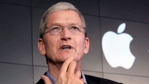 In this April 30, 2015, file photo, Apple CEO Tim Cook responds to a question during a news conference at IBM Watson headquarters, in New York. (AP Photo/Richard Drew, File)