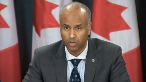 Canada's Minister of Immigration, Refugees and Citizenship, Ahmed Hussen speaks to the media in Ottawa on Sunday, Jan. 29, 2017.
