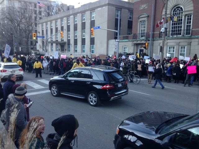 Protesters are gathering outside the U.S. Consulate in Toronto. (Cam Woolley/ CP24)