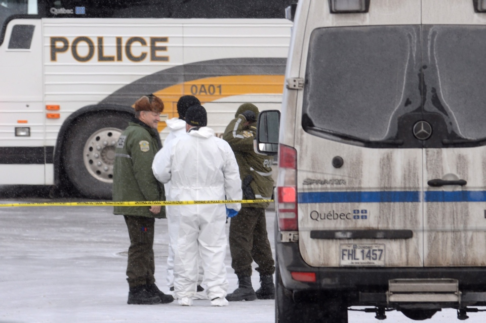Police attend the scene of a shooting at a Quebec City mosque on Monday January 30, 2017. A shooting at a Quebec City mosque left six people dead and eight others injured Sunday. THE CANADIAN PRESS/Paul Chiasson