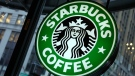 This Dec. 20, 2010 file photo shows signage at a Starbucks store in New York. (AP Photo/Richard Drew, File)