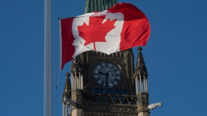 The flag flies at half-mast on a flag pole near the Peace tower Monday January 30, 2017 in Ottawa. It was announced Monday that the flag would fly at half-mast in memory of the victims of the Quebec City shooting. THE CANADIAN PRESS/Adrian Wyld