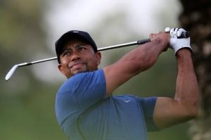 Tiger Woods tees off on the 11th hole during the first round of the Dubai Desert Classic golf tournament in Dubai, United Arab Emirates, Thursday, Feb. 2, 2017. (AP Photo/Kamran Jebreili)