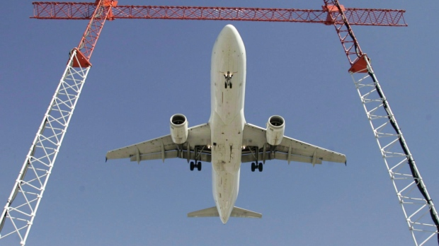 A flight makes its final approach as it lands at Pearson International Airport in Toronto on Sept. 30, 2004. THE CANADIAN PRESS/Adrian Wyld