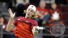 Canada's Denis Shapovalov returns the ball during first round Davis Cup tennis action against Great Britain's Kyle Edmund, Sunday, Feb. 5, 2017 in Ottawa. THE CANADIAN PRESS/Justin Tang