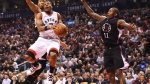 Toronto Raptors guard Kyle Lowry (7) drives between LA Clippers forward Wesley Johnson (33) and Clippers guard Jamal Crawford (11) during first half NBA basketball action in Toronto on Monday, Feb.6, 2017. THE CANADIAN PRESS/Frank Gunn