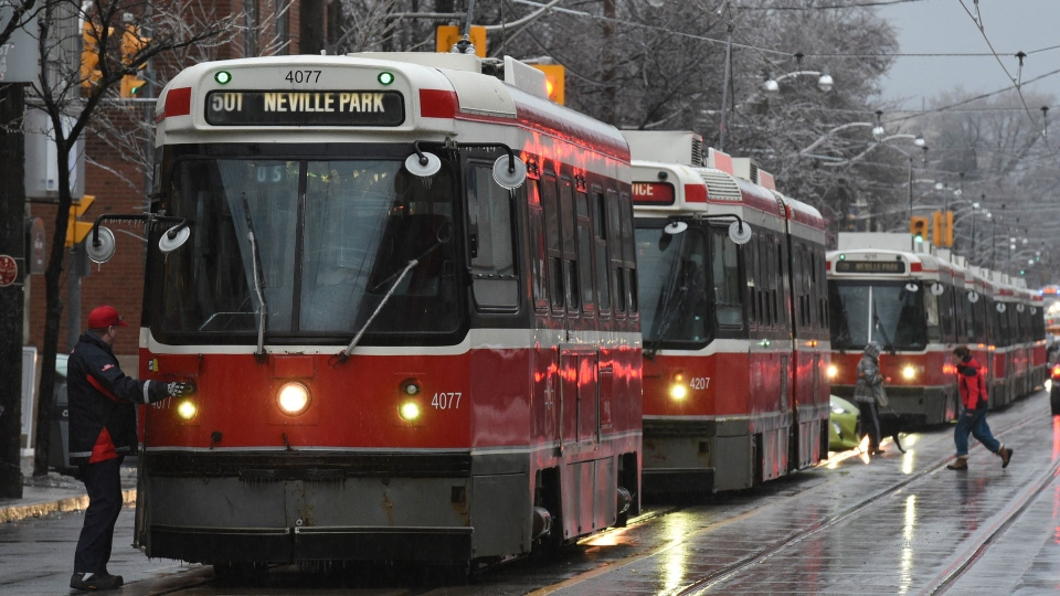 Streetcars are backed up along Queen St. in Toronto, Tuesday, Feb.7, 2017. Freezing rain is forecast for central Ontario and the rest of the south as a weather system moves across the province.THE CANADIAN PRESS/Frank Gunn