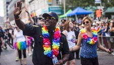 Toronto's police chief says he understands the LGBTQ community is divided and decided his force wouldn't participate in the city's parade to enable those differences to be addressed. Toronto police chief Mark Saunders marches during the annual Pride Parade in Toronto, in a July 3, 2016, file photo. (THE CANADIAN PRESS/Mark Blinch)