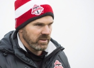 Toronto FC head coach Greg Vanney walks to the field during practice ahead of the MLS championship final match against the Seattle Sounders in Toronto on Wednesday, December 7, 2016. Toronto FC leaves the snow for the warmth of Florida on Monday, kicking off the most important part of its training camp. THE CANADIAN PRESS/Nathan Denette