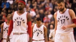 Toronto Raptors guard Kyle Lowry (7) and teammates walk off the court after losing to the Detroit Pistons in NBA basketball action in Toronto on Sunday, Feb.12, 2017. THE CANADIAN PRESS/Frank Gunn