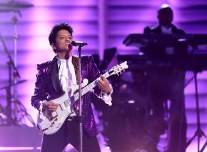Bruno Mars performs a tribute to Prince at the 59th annual Grammy Awards on Sunday, Feb. 12, 2017, in Los Angeles. (Photo by Matt Sayles/Invision/AP)