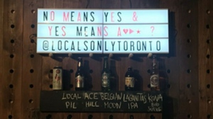 This photo posted on social media shows a sign spotted at Locals Only on King West.