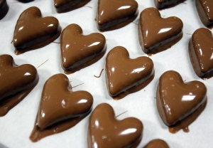 Chocolate-covered caramel hearts are laid out at Daisy's Olde Time Confections Tuesday, Jan. 13, 2015, in Twin Falls, Idaho. (AP Photo/The Times-News, Drew Nash)