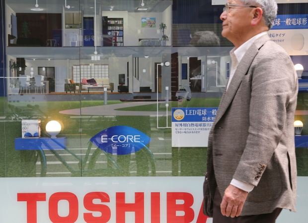 Toshiba chairman resigns as company shares dive after delaying financial results