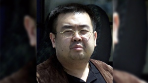 In this May 4, 2001, file photo, a man believed to be Kim Jong Nam, the eldest son of then North Korean leader Kim Jong Il, walks out of a police van before boarding an airplane heading to Beijing at Narita international airport in Narita, northeast of Tokyo. (Shizuo Kambayashi/AP)