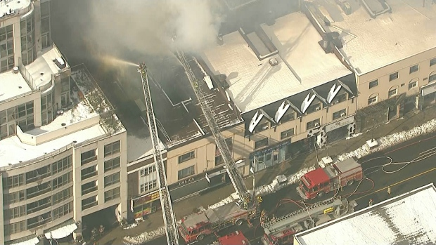 Toronto firefighters continue to battle hot spots in six-alarm blaze