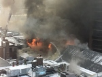 Crews battle a massive fire at on St. Clair in Toronto's Deer Park neighbourhood on Feb. 14, 2017.  (Twitter/ Sarah @sarahU277)