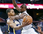 Indiana Pacers' Glenn Robinson III, left, passes the ball as Orlando Magic's Serge Ibaka defends during the first half of an NBA basketball game, Wednesday, Feb. 1, 2017, in Orlando, Fla. The Toronto Raptors have finally got the defensive big man they've been coveting.A source tells The Canadian Press that the Raptors have acquired Ibaka from the Orlando Magic for Terrence Ross plus a first-round pick in the 2017 NBA draft. THE CANADIAN PRESS/AP/John Raoux