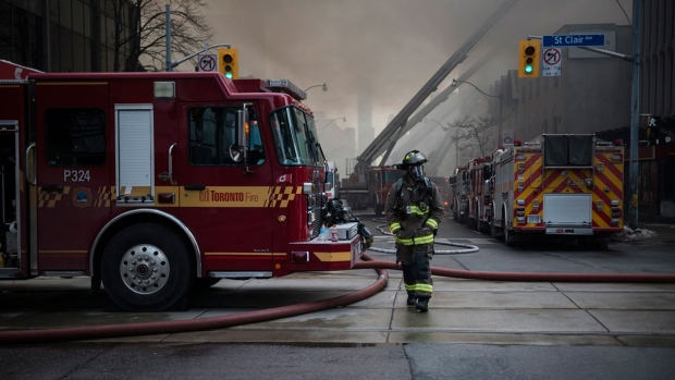 Firefighters battle a six-alarm fire on Yonge St. south of St.Clair Ave. in Toronto on Tuesday, February 14, 2017. THE CANADIAN PRESS/Christopher Katsarov