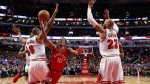 Toronto Raptors' DeMar DeRozan (10) shoots between Chicago Bulls' Cristiano Felicio (6) and Taj Gibson during the second half of an NBA basketball game Tuesday, Feb. 14, 2017, in Chicago. The Bulls won 105-94. (AP Photo/Charles Rex Arbogast)