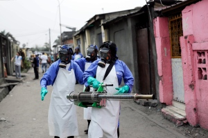 "In this Friday, July 22, 2016, file photo teams from MSF carry out fumigation efforts in the Yolo Sud neighborhood of Kinshasa, Democratic Republic of Congo, in a bid to kill the mosquitos that transmit yellow fever. The World Health Organization has declared an end to the yellow fever outbreak that killed about 400 people in Congo and Angola, calling it ""one of the largest and most challenging"" in recent years. The outbreak, first detected in Angola in late 2015, caused 965 confirmed cases and thousands of suspected cases in both countries, the WHO said in a statement Tuesday, Feb. 14, 2017. (AP Photo/Jerome Delay, File)"