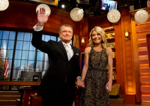 "In this Friday, Nov. 18, 2011, file photo, Regis Philbin and Kelly Ripa appear on Regis' farewell episode of ""Live! with Regis and Kelly"", in New York. Philbin said he hasn't kept in touch with Ripa, his former co-host, since he decided to leave the show they headlined together. (AP Photo/Charles Sykes, File)"