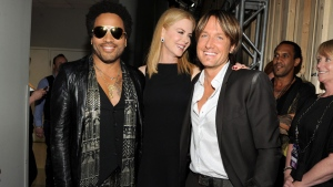 Singer Lenny Kravitz, left, actress Nicole Kidman and country singer Keith Urban pose at the 2013 CMT Music Awards at Bridgestone Arena on Wednesday, June 5, 2013, in Nashville, Tenn. (Photo by Frank Micelotta/Invision/AP)