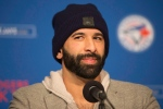 Toronto Blue Jays' Jose Bautista speaks to the media about re-signing with the club, at press conference in Toronto on Saturday, January 21, 2017. THE CANADIAN PRESS/Chris Young