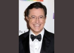 """In this Dec. 6, 2015 file photo, Stephen Colbert attends the 38th Annual Kennedy Center Honors at The Kennedy Center Hall of States in Washington. Colbert is going to have his say after President Donald Trump's address to a joint session of Congress. CBS said that """"The Late Show"""" will air live at 11:35 p.m. EST Tuesday, the night of Trump's scheduled speech. (Photo by Greg Allen/Invision/AP, File)"""