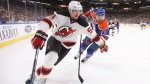New Jersey Devils' Sergey Kalinin (51) is chased by Edmonton Oilers' Oscar Klefbom (77) during first period NHL action in Edmonton, Alta., on Thursday January 12, 2017. THE CANADIAN PRESS/Jason Franson