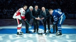 Ottawa Senators defenceman Erik Karlsson (65), left to right, with Brad Conacher, son of former Maple Leafs player Charlie Conacher, along with former Maple Leafs players Frank Mahovlich, Wendel Clark, Casey Kelly, daughter of former Maple Leafs player Red Kelly, and Toronto Maple Leafs defenceman Morgan Rielly (44) pose for a photo during a ceremonial faceoff during a pre-game ceremony to honour the former players with their names on the Legends Row, ahead of NHL hockey action in Toronto on Saturday, February 18 2017. THE CANADIAN PRESS/Aaron Vincent Elkaim