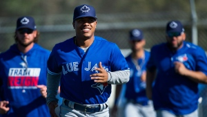 Toronto Blue Jays starting pitcher Marcus Stroman warms up during baseball spring training in Dunedin, Fla., on Monday, February 20, 2017. THE CANADIAN PRESS/Nathan Denette