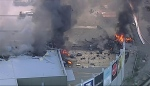 This image made from video shows the site of a plane crash at Essendon Airport in Melbourne, Australia Tuesday, Feb. 21, 2017. An official says a light plane has crashed into a shopping mall in the city of Melbourne. (Channel 9 via AP)