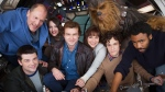 "In this undated image provided by Lucasfilm, cast members and co-directors of the Han Solo ""Star Wars"" spin-off pose for a photo, from bottom left, co-director Christopher Miller, Woody Harrelson, Phoebe Waller-Bridge, Alden Ehrenreich, Emilia Clarke, Joonas Suotamo as Chewbacca, co-director Phil Lord and Donald Glover. (Jonathan Olley/Lucasfilm via AP)"