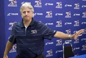 Montreal Alouettes general manager Jim Popp leaves a news conference in Montreal on Thursday, August 1, 2013. Popp is the leading candidate for the Toronto Argonauts' vacant GM position. THE CANADIAN PRESS/Paul Chiasson