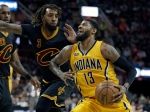 Indiana Pacers' Paul George (13) drives past Cleveland Cavaliers' Derrick Williams (3) in the second half of an NBA basketball game, Wednesday, Feb. 15, 2017, in Cleveland. (AP Photo/Tony Dejak)