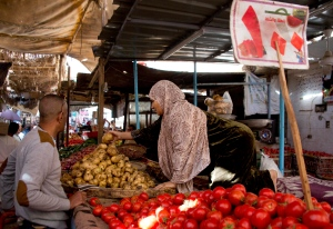 In this Nov. 25, 2016 file photo, a vegetable vendor sells produce at a market in Cairo, Egypt. Egypt is seeing a dramatic jump in the country's annual urban consumer price inflation. In a Tuesday, Jan. 10, 2017, statement, the state-run Central Agency for Public Mobilization and Statistics said that inflation has reached a record high of 24.3 percent, the highest in six years. The agency said food and beverage prices increased around 5.2 percent in December, and that medical care jumped to nearly 5.6 percent, compared to November. (AP Photo/Amr Nabil, File)