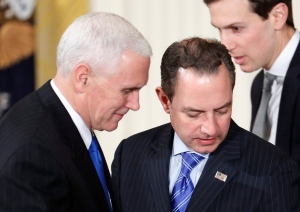 Vice President Mike Pence and White House Chief of Staff Reince Priebus arrive in the East Room of the White House in Washington, Thursday, Feb. 16, 2017, for President Donald Trump's news conference. (AP Photo/Pablo Martinez Monsivais)