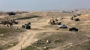 Iraqi and U.S. forces deploy near Mosul's international airport, in western Mosul, Iraq, Feb. 24, 2017. (AP Photo/ Khalid Mohammed)