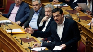 Greek Prime Minister Alexis Tsipras speaks during a Parliament session about bailout negotiations in Athens, Friday, Feb. 24, 2107.  (AP Photo/Thanassis Stavrakis)