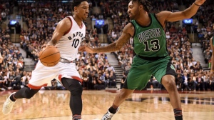 Toronto Raptors' DeMar DeRozan (10) drives to the net under watch by Boston Celtics' James Young during second half NBA basketball action in Toronto on Friday, February 24, 2017. THE CANADIAN PRESS/Frank Gunn