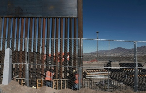 "In this Jan. 25, 2017, file photo, workers continue work raising a taller fence in the Mexico-US border area separating the towns of Anapra, Mexico and Sunland Park, N.M. U.S. Customs and Border Protection said Friday, Feb. 24, 2017, that it plans to start awarding contracts by mid-April for President Donald Trump's proposed border wall with Mexico, signaling that he is aggressively pursuing plans to erect ""a great wall"" along the 2,000-mile border. (AP Photo/Christian Torres, File)"