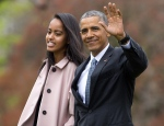"In this April 7, 2016 file photo, President Barack Obama and his daughter Malia, walk across the South Lawn of the White House in Washington before boarding Marine One helicopter for the short flight to Andrews Air Force Base. Former President Obama and his daughter Malia Obama have caught a new revival of Arthur Miller's ""The Price."" They attended the play starring Danny DeVito, John Turturro, Tony Shalhoub and Jessica Hecht at the American Airlines Theatre on Friday, Feb. 24, 2017, in New York. (AP Photo/Pablo Martinez Monsivais, File)"
