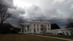 Storm clouds are seen over the White House as a cold front passes through the area, Saturday, Feb. 25, 2017, in Washington. (AP Photo/Alex Brandon)