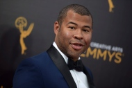 "FILE - In this Sept. 11, 2016, file photo, Jordan Peele arrives at night two of the Creative Arts Emmy Awards in Los Angeles. The trailer for Peele's upcoming film, ""Get Out,"" debuted online on Oct. 4, 2016. (Photo by Richard Shotwell/Invision/AP, File)"