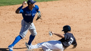 Toronto Blue Jays' Christian Lopes attempts a double play after New York Yankees' Francisco Diaz is forced out during a spring training baseball game, Sunday, Feb. 26, 2017, in Tampa, Fla. (AP Photo/Matt Rourke)